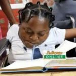 Girl Writes BECE Exam With Pen In Mouth